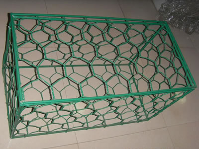 A green PVC-coating gabion box on the floor.