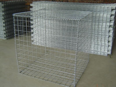 A welded type  Galfan coated gabion cage on the ground with several panels on the beside of it.
