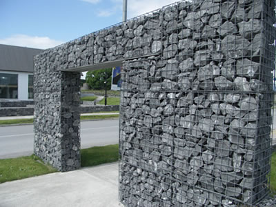 A door shaped welded gabion are installed on the road.
