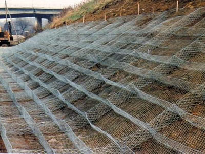 Several galvanized gabion mattresses is lying on the slope.
