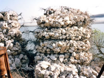 Several sack gabions are stacked up into mountain shapes.